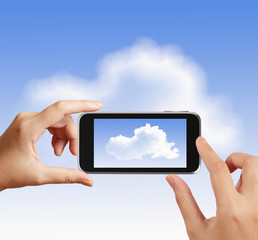 Smart hand using touch screen phone take photo of cloud icon as