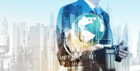 Double exposure of business engineer holding the earth and abstr
