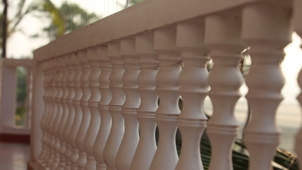 balcony rail close to the beach background and palm trees in the