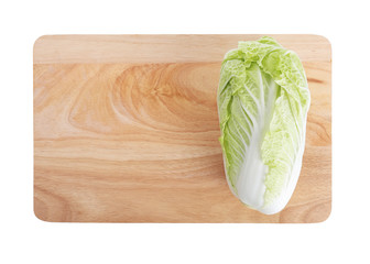 isolated chinese cabbage on wooden chopping board