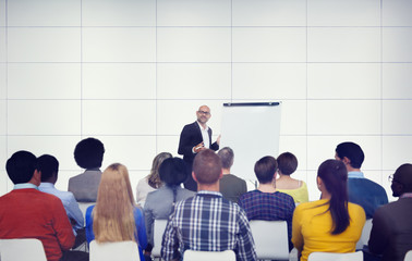 Businessman Presenting in Front of Audience