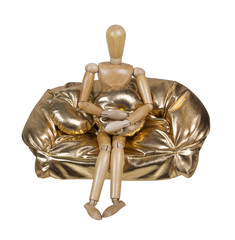 Sitting on a Golden Plump Couch Holding a Cushion