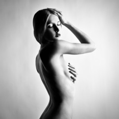 Fashion photo of beautiful nude woman. Black and white