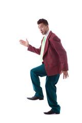 Studio shot of merry man posing in large suit