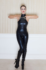 Brunette woman in latex catsuit