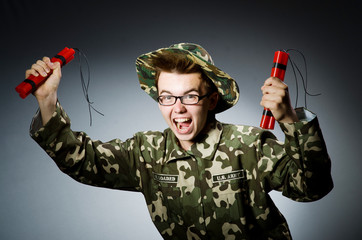 Funny soldier with red dynamite