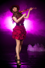 girl with a violin on stage