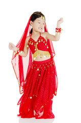 Little in traditional indian costume and dancing
