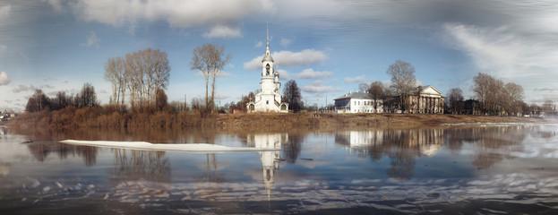 Spring flood church on the bank