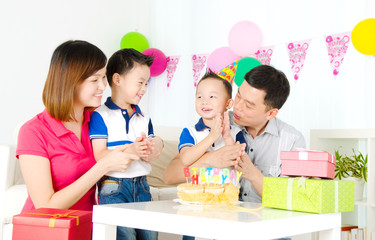 Asian family celebrating birthday