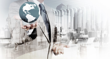 Double exposure of business  holding the earth and abstract city
