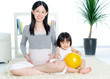 Asian pregnant woman and  daughter