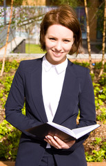 young business woman holding a diary.