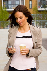young woman with coffee and phone.