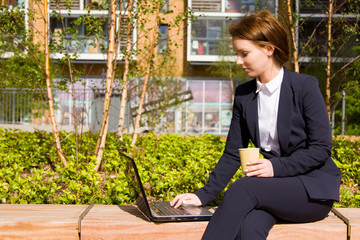 young business woman working outdoors.