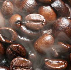 Roasted Coffee bean background with smoke on surface