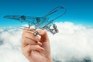 hand drawing airplane on blue sky background
