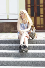 teen girl sitting on the stairs