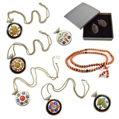 Set with medallions and necklaces isolated