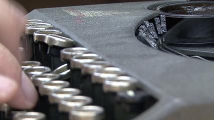 hand on a typewriter keyboard