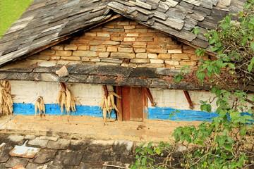 Corncobs-stone wall-slate roof. House in Landruk-Nepal. 0574