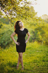sexy lady in a summer garden, posing