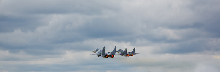 Two MiG 29 with  camouflage  against clear sky