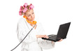 Woman talking on phone and working on laptop