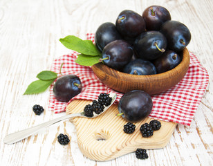Fresh purple plums and blackberry
