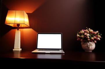 Closeup image of a workplace at home with laptop