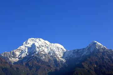 Mounts Annapurna South and Hiun Chuli (L-R). Landruk-Nepal. 0587