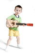 Child playing on guitar isolated on a white background
