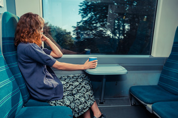 Young woman sitting on train