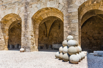 Templar knights castle court with cannonbals