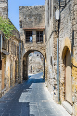 Arched narrow street in Rhodes old town