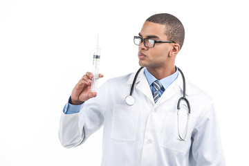 African American doctor holding syringe.