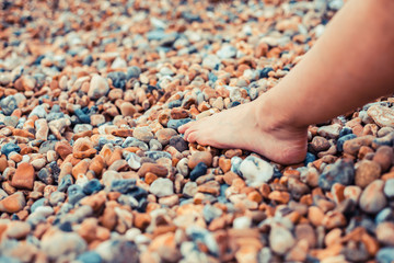 The foot of a young woman on the beach