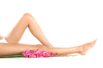 Healthy female legs on white background.