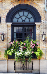 Old buildind window and flowers