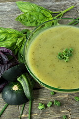 Soup with zucchini, basil and chives
