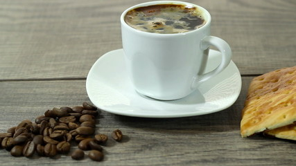 white cup of coffee costs on a wooden table