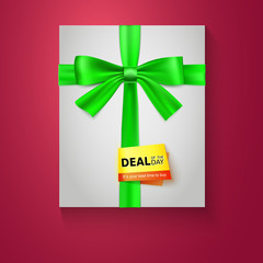 Gift box with green bow on red background. Deal of the day.