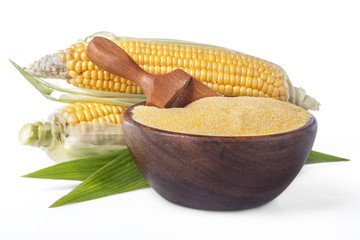 corn with grits polenta in a wooden bowl on white