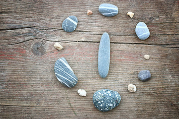 stones on a wooden background