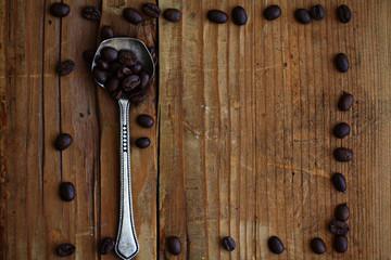 wooden background coffee grains