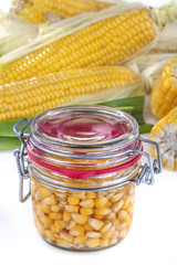 glass jar filled with sweet canned corn
