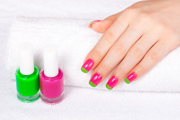Woman is getting manicure in a beauty salon