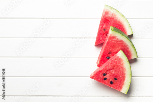 Fotobehang Vruchten sliced watermelon on kitchen table