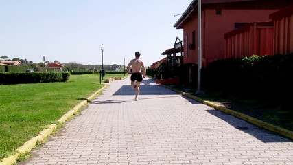 Muscular man jogging shirtless