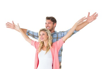 Attractive young couple standing with hands out